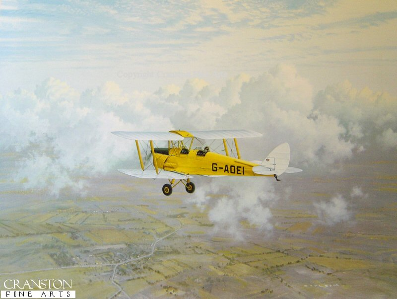 Tiger Moth G-AOEI owned by Cambridge Flying Group over the Cambridge countryside.