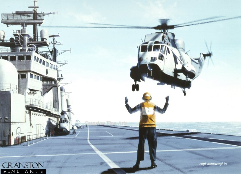 A Sea King helicopter landing on an Illustrious class carrier.