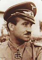 Adolf Galland fought in the great Battles of Poland, France and Britain, leading the famous JG26 Abbeville Boys.  He flew in combat against the RAFs best including Douglas Bader, Bob Stanford Tuck and Johnnie Johnson.  In 1941, at the age of 29, he was promoted to Inspector of the Fighter Arm.  In 1942 Hitler personally selected Galland to organise the fighter escort for the Channel Dash.  He became the youngest General in the German High Command but open disagreements with Goering led to his dismissal at the end of 1944.  He reverted to combat flying, forming the famous JV44 wing flying the Me262 jet fighter, and was the only General in history to lead a squadron into battle.  With 104 victories, all in the West, Adolf Galland received the Knights Cross with Oak Leaves, Swords and Diamonds.  Born 19th March 1912, died 9th February 1996.  Born in 1911, Adolf Galland learned to fly at a state-sponsored flying club in the early 1930s. In 1933 he was selected to go to Italy for secret pilot training. Galland flew for a brief time as a commercial airline pilot prior to joining the clandestine Luftwaffe as a Second Lieutenant. In April of 1935 he was assigned to JG-2, the Richtofen Fighter Wing, and in 1937 he joined the ranks of the Condor Legion flying the He-51 biplane fighter in support of General Franco during the Spanish Civil War. Despite flying 280 missions, Galland attained no aerial victories, a rather inauspicious start for a pilot would go on to attain more than 100 aerial victories - the highest for any pilot who flew on the Western Front. During Germanys invasion of Poland, Galland was assigned to an attack squadron and he flew over fifty ground sorties. He was promoted to Captain for his efforts, but Galland was anxious to return to a fighter squadron, and he got his wish in October of 1939 when he was transferred to JG-27. It was with JG-27 that Galland first learned to fly the Bf-109. In May of 1940 JG-27 flew in support of the invasion of Belgium, and Galland achieved his first combat victory on May 12. Two months later his score had risen to more than a dozen, and at this time he was once again transferred to JG-26 situated on the Channel Coast. Engaging the RAF on a daily basis during the Battle of Britain, Gallands score rose steadily until it exceeded 40 victories by September. After a short leave Galland rejoined JG-26 in Brittany, where the squadron played a defensive role. Following Germanys invasion of Russia in June of 1941, JG-26 became one of only two German fighter squadrons left on the Channel Coast. This resulted in plenty of flying, and by late in 1941 Gallands victory totals had reached 70. Following a near brush with death when the fuel tank of his 109 exploded, Galland was grounded for a time, and sent to Berlin where he was made the General of the Fighter Arm, reporting directly to Goring and Hitler. Galland spent most of the next few years carrying out inspection tours, and was at odds with his superiors about the need for an adequate fighter defense to negate ever-increasing Allied bombing of Germanys cities. He continued to fly combat missions when the opportunity presented itself, despite Gorings orders to the contrary. In January of 1945 almost 300 fighters were lost in an all-out attack on Allied airfields in France, a mission Galland did not support. He was dismissed as General of the Fighter Arm for his insubordination, but reflecting his flying abilities Hitler ordered Galland to organize JV-44, Germanys first jet-equipped fighter squadron. By March of 1945 Galland had recruited 45 of Germanys best surviving fighter pilots, and this new squadron was given the difficult task of trying to counter the daily onslaught of 15th Air Force bombers coming at Germany from the South. Gallands final mission of the War occurred on April 26 when he attained his 102nd and 103rd confirmed aerial victories prior to crash landing his damaged Me262. Several days later the War was over for both Galland and Germany. General Galland died in 1996.