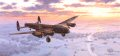 A snow covered landscape bathed in early morning sun provides welcome relief for the crew of an Avro Lancaster B1 of 15 Sqd as it returns from a night mission over Germany.