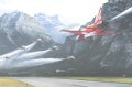 In the narrow valley dominated by the 3000 metre high Mt Glarnish the Patrouille Suisse Tigers line up over the runway of the satellite airfield of Mollis as solo Paul Thoma streaks underneath in the dramatic <i>Tunnel</i> manoeuvre.  ......