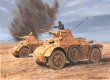 North Africa, 18th November 1941.  Italian Autoblinda armoured cars of Gen. Gambara's XX Mobile Corps trade shots with forward reconnaissance elements of the British 22nd Armoured Brigade, during the initial hours of Operation Crusader.  Their quick withdrawal to report their contact would give the Italian main force a timely warning of the unexpected attack.